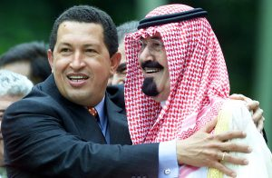 CARACAS, VENEZUELA:  Venezuelan President Hugo Chavez (L) hugs Saudi Arabian Crown Prince Abdullah Ibn Abdul Aziz Al-Saud during the official photo session at the end of the OPEC II Summit of oil producing countries in Caracaas 28 September, 2000.      AFP PHOTO     OMAR TORRES (Photo credit should read OMAR TORRES/AFP/Getty Images)
